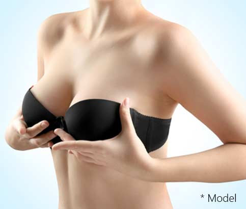 Woman breast, closeup. Plastic correction and surgery concept