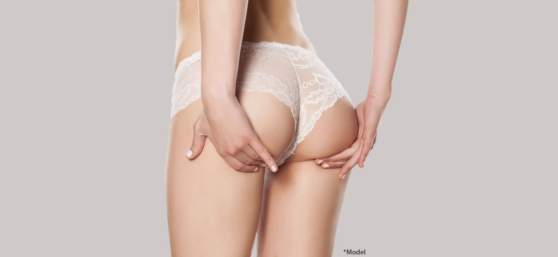 Cropped image of woman in white lingerie lifting her buttocks