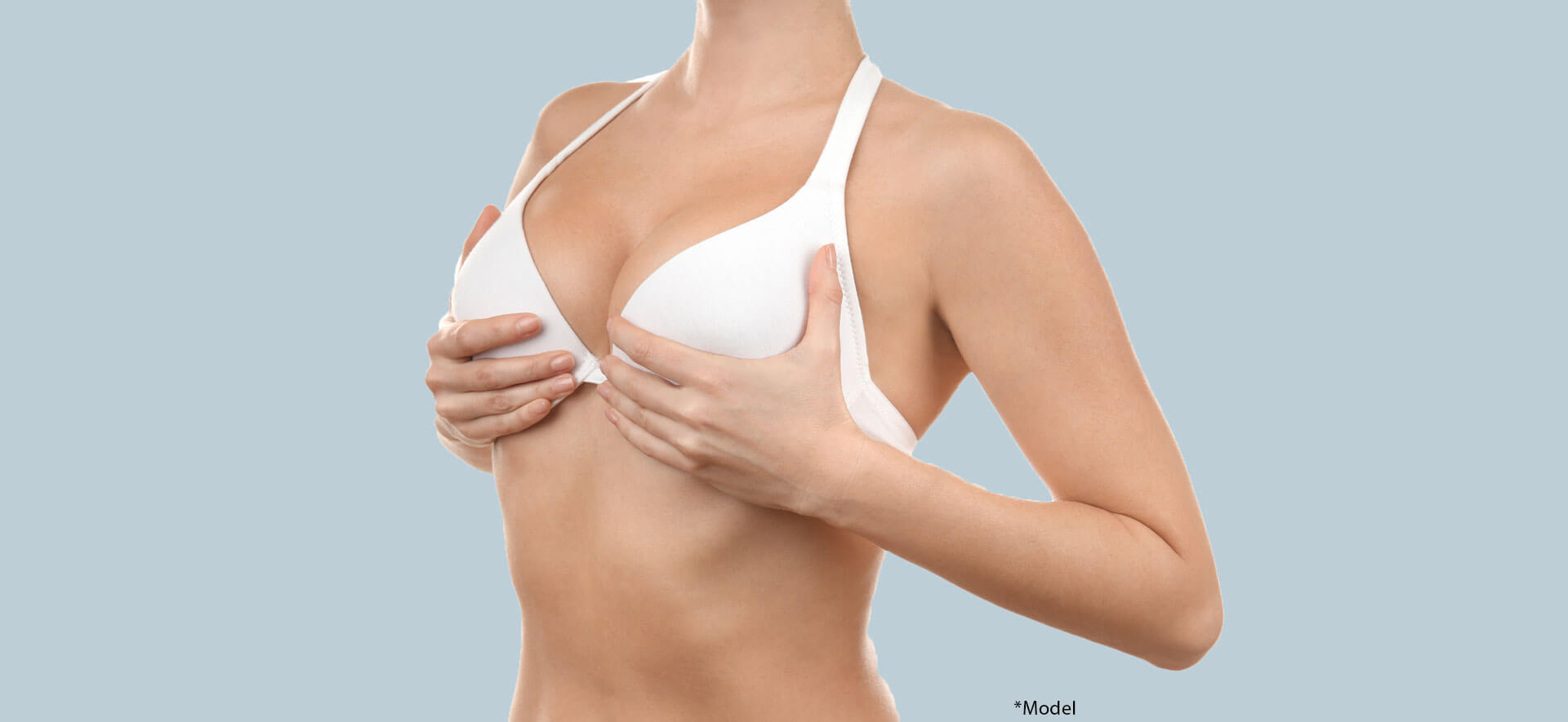 Woman lifting her breasts. Plastic surgery concept
