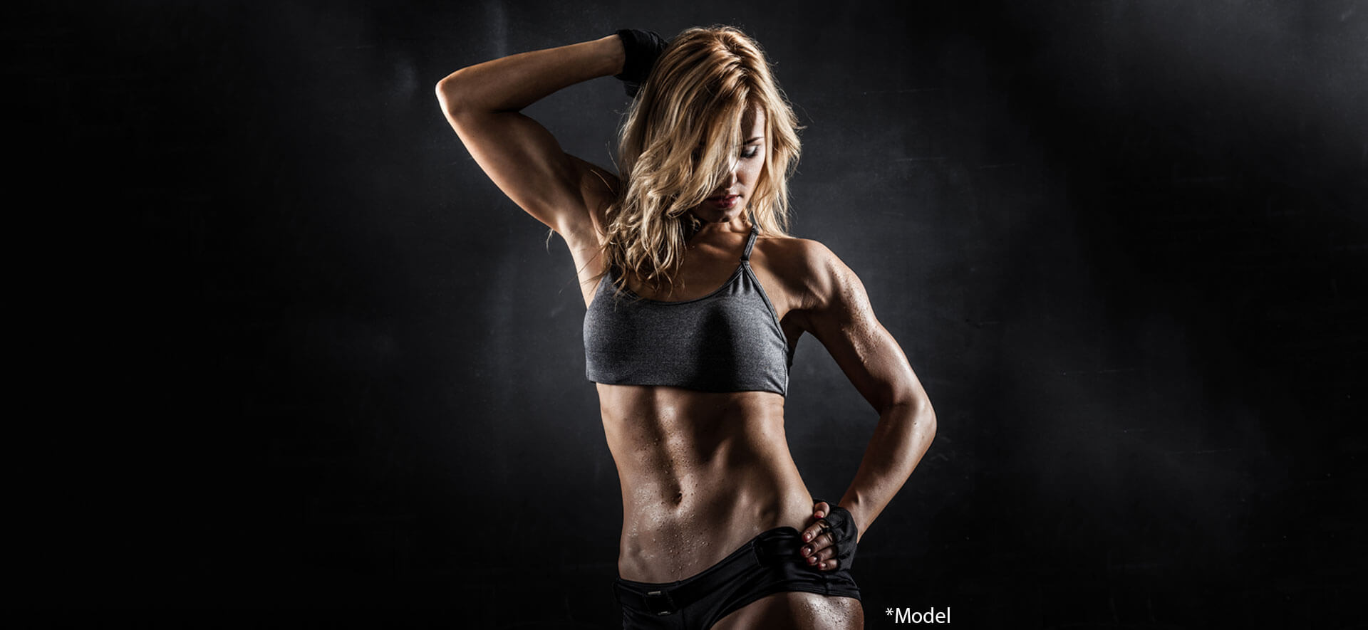 Fitness model in dark background