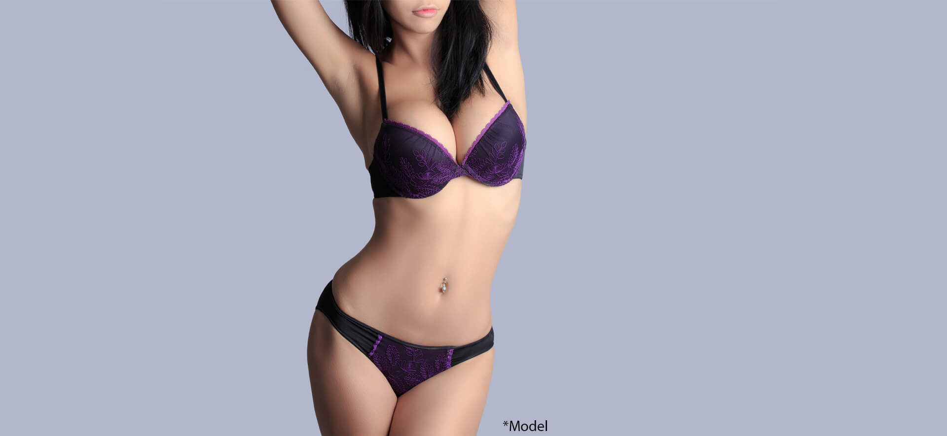 Beautiful slim body of woman in grey background